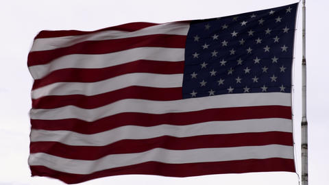 United States flag blowing the breeze ビデオ