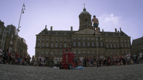 AMSTERDAM, NETHERLANDS - CIRCA 2013: Static shot of acrobat juggling and balanci Footage