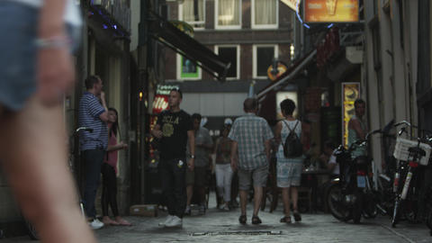 AMSTERDAM, NETHERLANDS - CIRCA 2013: Shot of activities on a cobbled street on 2 Footage