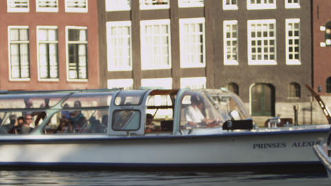 AMSTERDAM, NETHERLANDS - CIRCA 2013: Shot of a cruising ferry boat with people o Footage