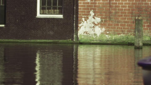 Static shot of the river canal and a building facade in Amsterdam, Netherlands Footage
