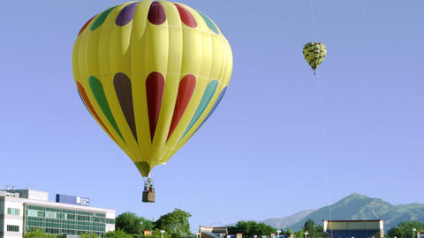 Shot of an assortment of hot air balloons in Utah Footage
