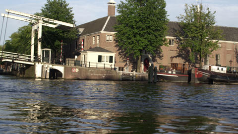 Tracking shot of drawbridge and downtown Amsterdam in Netherlands Footage