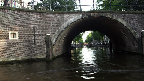 Tracking shot of bridges over the Amsterdam Canal in Netherlands Footage