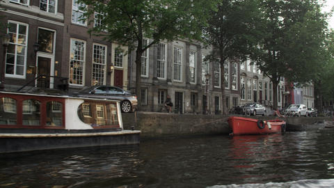 Tracking shot of a street alongside the Amsterdam canal in Netherlands Footage