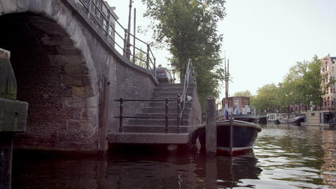 Sped-up footage of beautiful houseboats on the canal in Amsterdam, Netherlands Footage