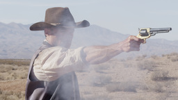 Slow motion of cowboy lifting and shooting his pistol Footage