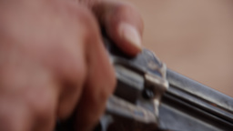 Up close view of bullets in mans hands as he loads his old pistol Footage