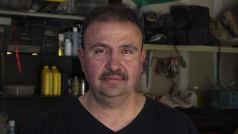 Mechanic with sad look on his face slightly shaking head Footage