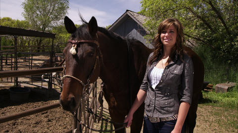 Panning view of girl standing next to horse Footage