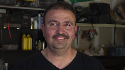 Mechanic with big smile on face Live Action