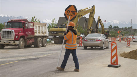 Static shot of a road construction crew with a digging backhoe Footage