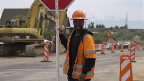 TIlt shot of a black road construction worker Footage