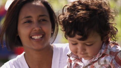 Slow handheld shot of a smiling Indian mother and her child Live Action