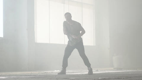 Confident young passionate hip-hop dancer performing in the fog. Hip hop culture Footage