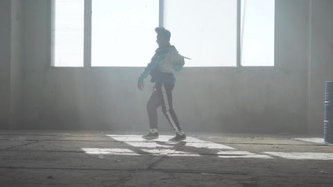 Skillful young man dancing in an abandoned building. Hip hop culture. Rehearsal Footage