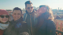 Millennial People in Sunglasses: Four Adult Friends are Making Selfie Video Archivo