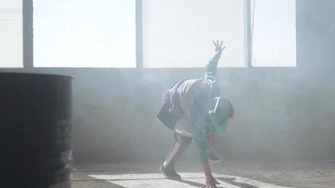 Skillful young man dancing in an abandoned building. Hip hop culture. Rehearsal Live Action