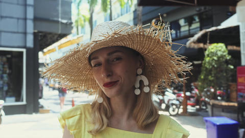Young Beautiful woman in straw hat walk straight to the camera and smiles Live Action