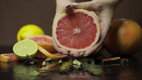 Woman squeezing a fresh and juicy grapefruit with hands.... Stock Video Footage