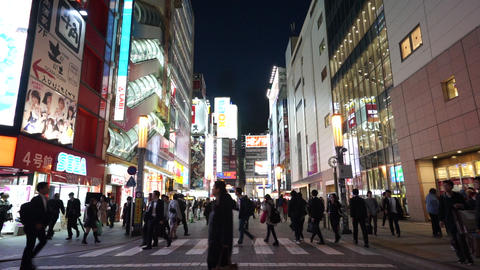 Crowd of tourist are travelling in Akihabara shopping district , Tokyo city, Japan Live Action