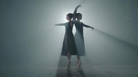 Two graceful professional ballerinas dancing on her pointe ballet shoeses in Footage