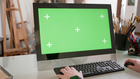 Male hands typing a text on the keyboard in front of a green screen GIF