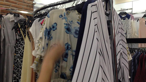 women choose cloth shop Stock Video Footage