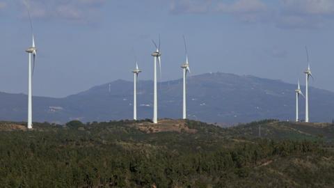 Windmills or wind turbine on wind farm in rotation Footage
