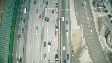 Aerial view of the beginning of a city road traffic jam in a business district Live Action