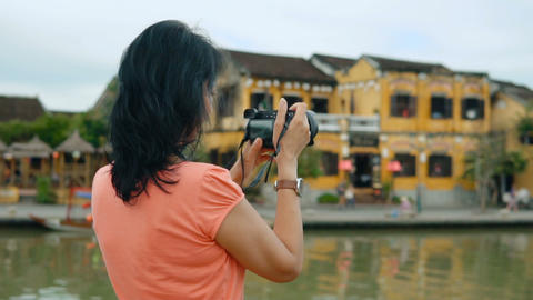 Attractive woman taking pictures Footage