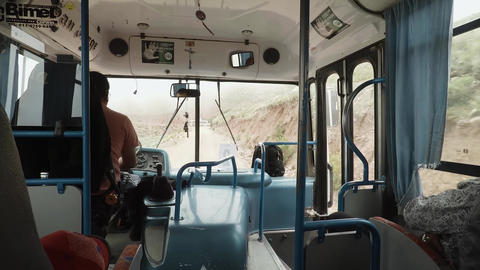 Inside bus on cliff Live Action