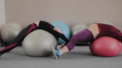 Positive fat couple exercising with fitness balls Footage