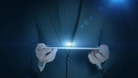 business man holding tablet hologramm hud projection bulb... Stock Video Footage