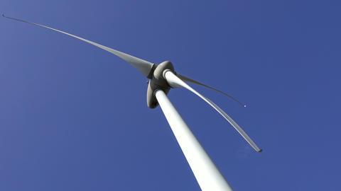 Windmill or wind turbine on wind farm in rotation Footage