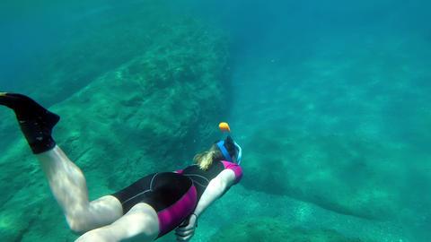 Cute snorkeling girl diving Archivo