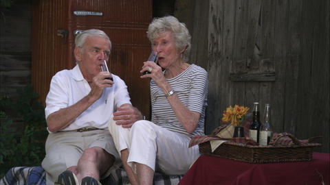 Slow motion static shot of an elderly couple having a picnic at a farm Footage