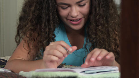 Up close slow motion of girl writing in her diary Footage