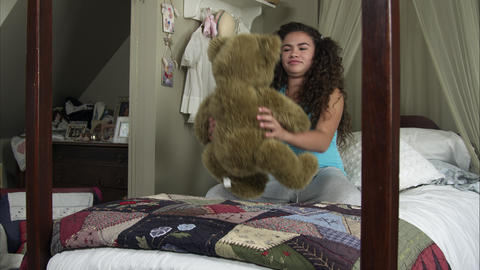 Slow motion of girl playing with bear Footage