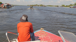 Boat Through River With Floating Village,Tonle Sap,Cambodia stock footage
