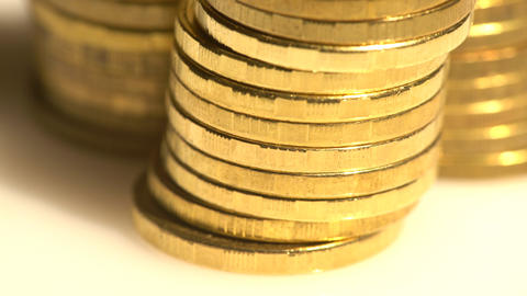 Closeup on golden coin piles Footage