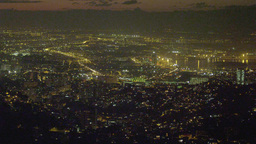 Longer pan of the Rio de Janeiro cityscape at night Footage