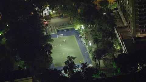 Longer clip of a birds eye view of a late night soccer stadium in Rio de Janeiro Footage