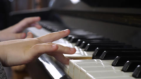 Little Girl's Hand Playing Piano Live Action