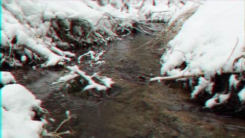 Glitch effect. Creek in the snow. It's snowing. Russia Live Action