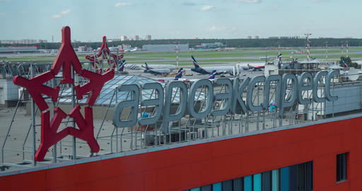 Timelapse of planes traffic and Aeroexpress banner at Sheremetyevo Airport Live Action