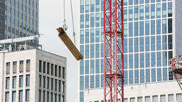 Construction Crane Transporting Wooden Planks Footage