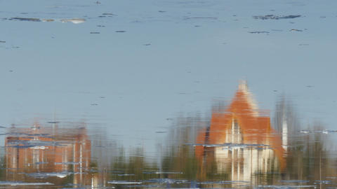 rural houses are reflected in the river Ice drift Footage