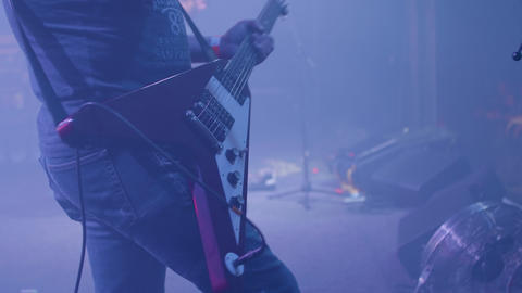 Rock musician with a guitar performs in front of a crowd... Stock Video Footage