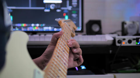 Musician artist playing guitar to record in sound mixing studio process of music creation with dark Footage